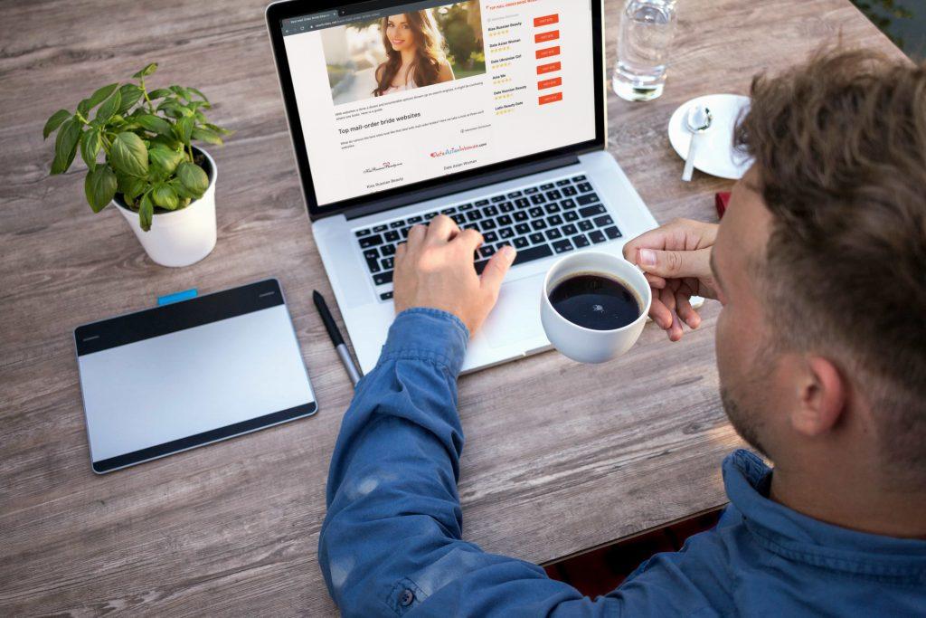 man reading newbrides on laptop